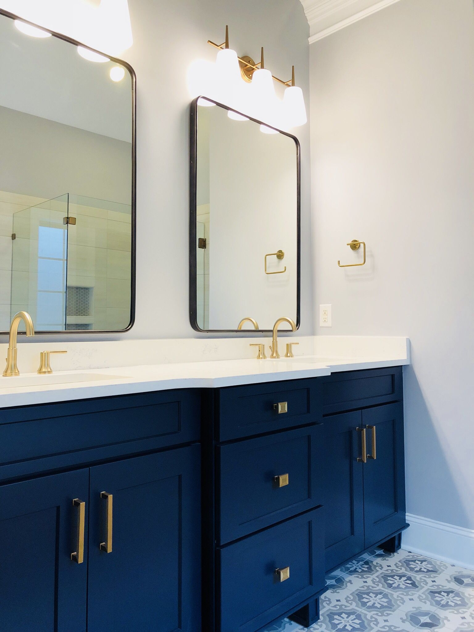 Champagne Bronze Fixtures Deep Navy Blue Vanity Oil Rubbed Bronze Mirrors And Light Grey Wal Blue Bathroom Vanity Bronze Bathroom Light Fixtures Blue Vanity