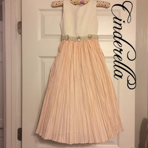 Cinderella Elagant Formal Girls Cinderella Elegant Formal   Size: Girls -Children's 8  100% polyester & beading around the bust line  This dress has 2 built in petticoats & a slip  It's a long very full dress.   ❌No Trades ❌If sold elsewhere it will be deleted here. Cinderella  Dresses