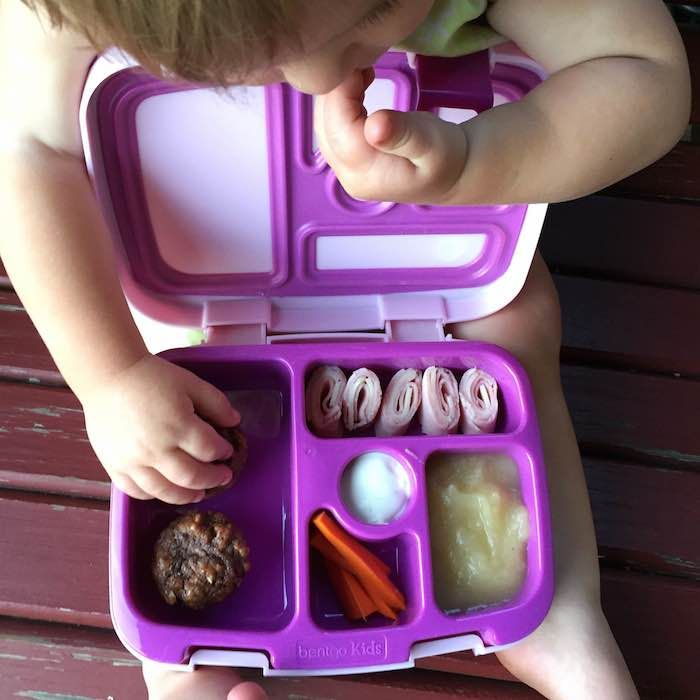A yummy lunchbox for your little one: ham and cheese rollups, unsweetened apple sauce, carrots with ranch, double chocolate mini muffins