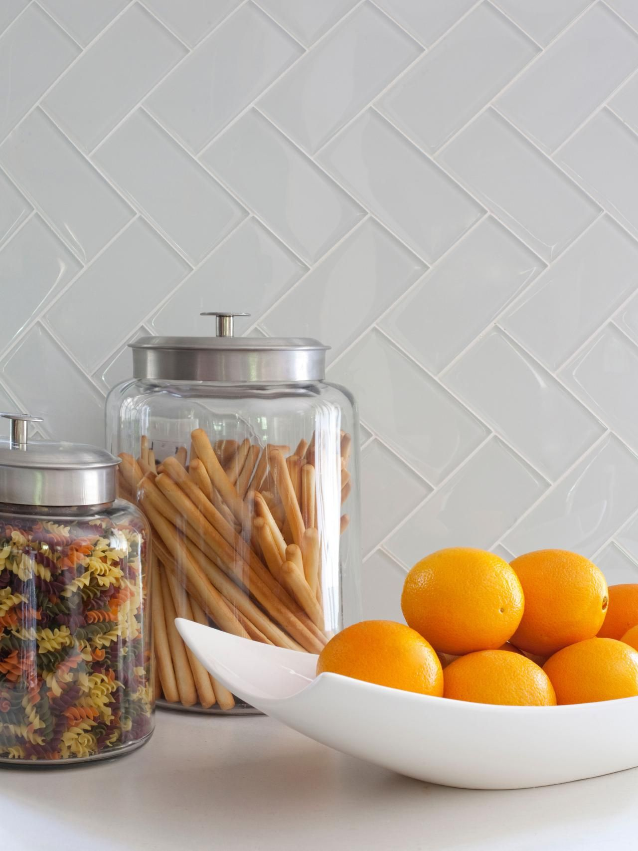 Glass tiles in  herringbone pattern create statement the new open kitchen also