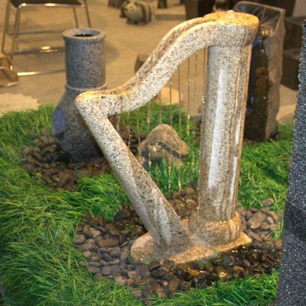 estupenda arpa fuente de piedra decoración