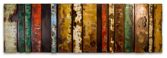 Colored metal bars that are welded onto a metal plate, painted and rusted?  Yep thats what color bars is in a couple of word. Handcrafted out of metal, this piece, ready to hang, makes your walls unique as it is itself.  Finally, now on SALE