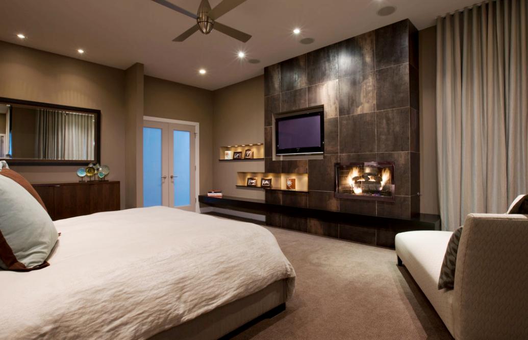 TV wall units, stone fireplace, custom bedding, natural