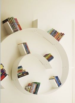 Book shelf. I like how the white-on-white disguises the shelf, so ...