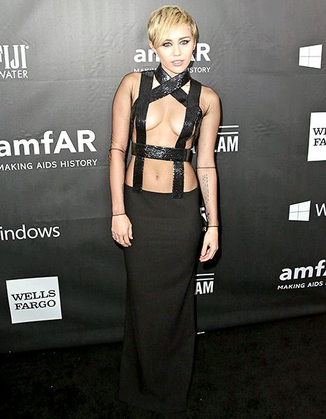67105891610393 Miley Cyrus left little to the imagination in a sexy Tom Ford gown which  exposed a lot of cleavage.