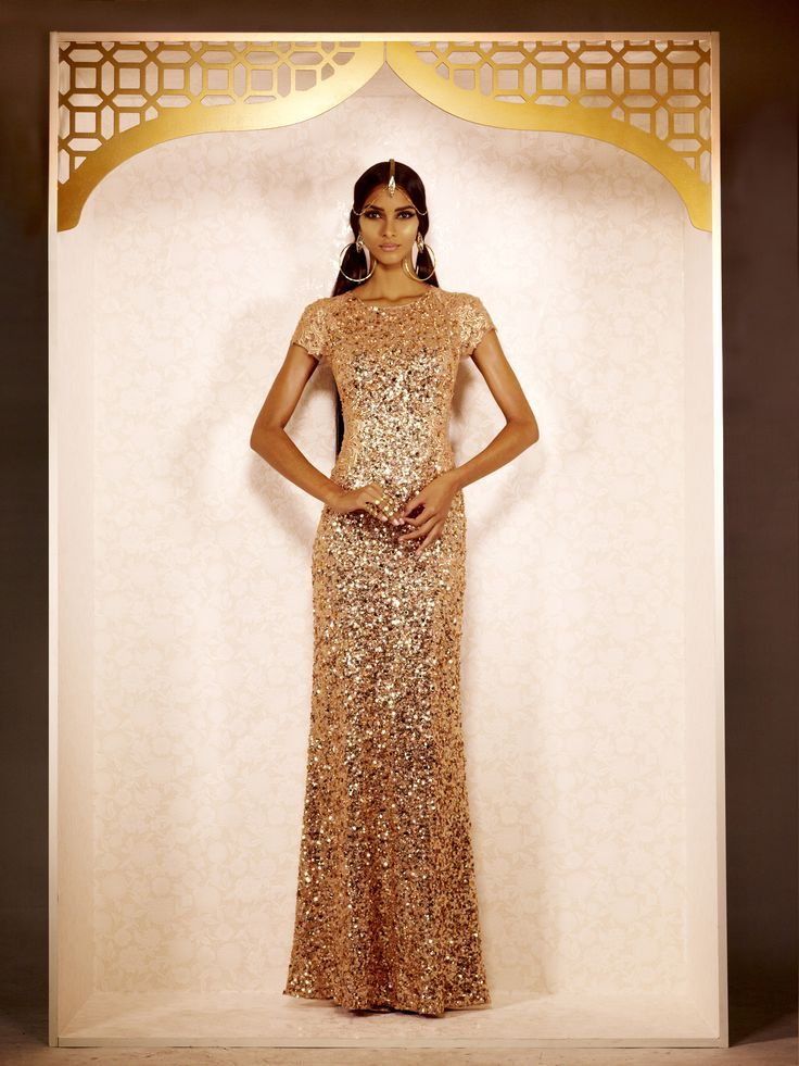 gold glitter indian wedding reception dress by Patricia