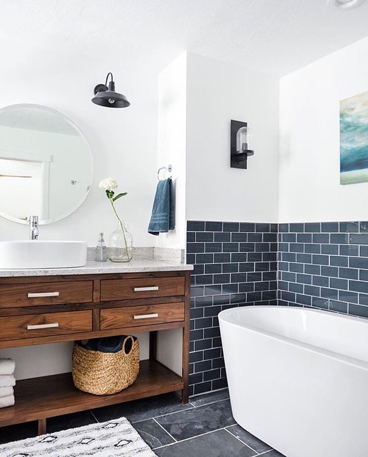 navy subway tile adds contrast against while walls to this bathroom with a standalone tub and wood vanity subway tile doesnt have to be white add a - Subway Tile House Interior