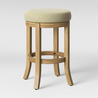 This Upholstered Cheshire Round Farmhouse Swivel Counter Stool