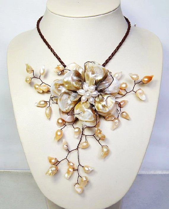 wired flower necklace with MOP shell freshwater pearl $18...would make a lovely brides necklace!