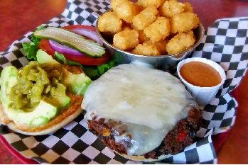 Cantina Burger - Crispy or grilled black bean burger topped with green chiles, avocado & chipotle ranch, cheddar & Monterey Jack cheeses. Substitute Beef, Chicken or Turkey