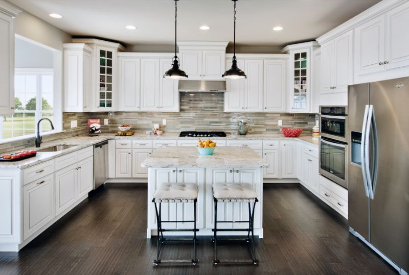 The White Cabinets And Dark Floors Were Made For Each Other Toll Brothers High Pointe At St