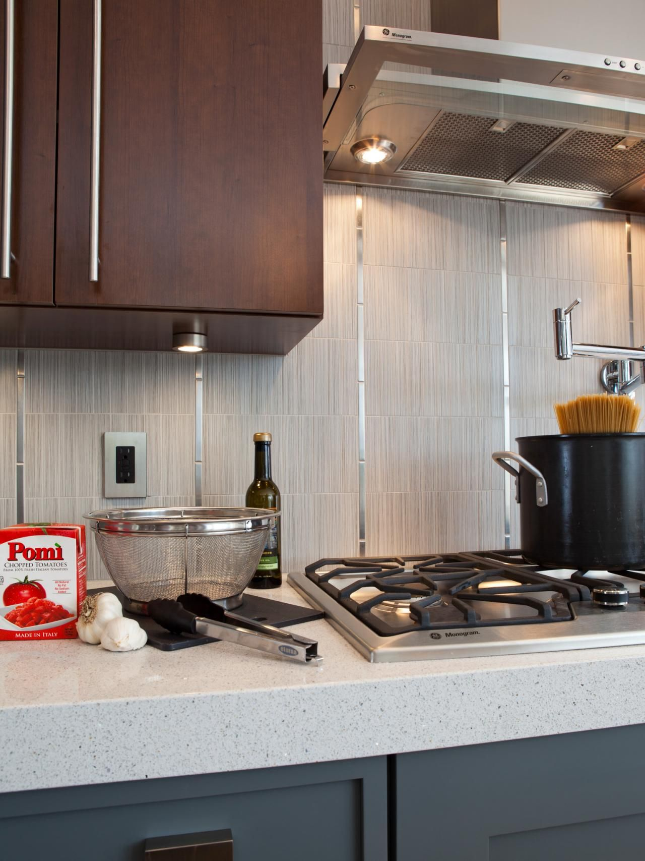A three inch thick white quartz countertop makes the countertop stand out as a focal point
