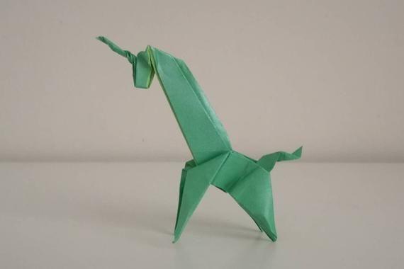 Photo of Handmade origami little green Unicorn (pearl coloured paper)