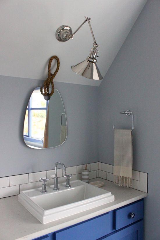 sunset magazine idea house brian paquette masterbath nautical mirror swing arm sconce in bathroom
