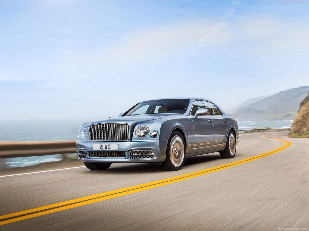 "2017 Bentley Mulsanne > In the new Bentley Mulsanne, the mighty 6¾-litre V8 develops 512 PS (505 bhp / 377 kW) and 1,020 Nm (752 lb.ft) of torque. This immense power - channelled though an eight-speed ZF automatic transmission. The sprint to 60 mph is dispatched in just 5.1 seconds en route to a top speed of 184 mph (296 km/h). With 20"" alloy wheels and 265/45 ZR 20 tyres as standard. Customers may also opt for 21"" wheels, available in three styles, fitted with 265/40 ZR 21 tyres."