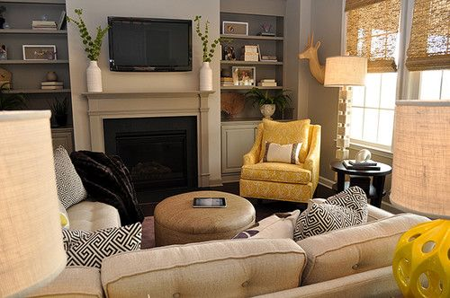 Yellow accent chair in neutral living room (black and white ...