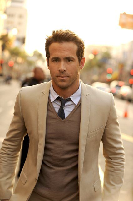 Ryan Reynolds rocking a suit + sweater.