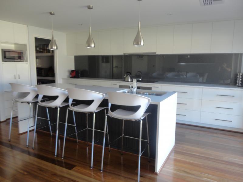 White Kitchen With Grey Splashback Concealed Rangehood
