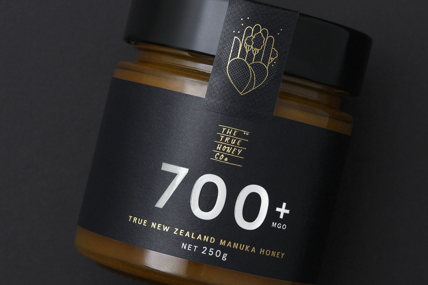 Brand identity and packaging by Marx Design for The True Honey Company, a New…