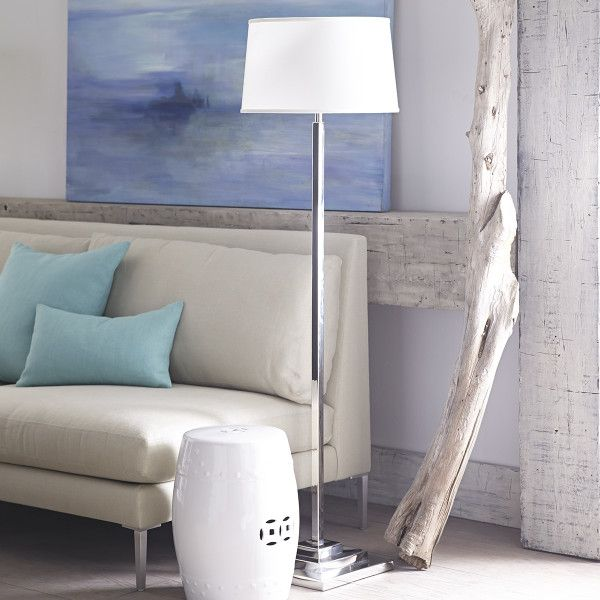 """Dimensions:12""""sq. x 54.25""""h Adds shine (and light!) to a room  So modern!  Functional style for a spaceA wonderful accent for contemporary décor, this floor lamp is oh-so-suave. With designer quality—skinny, yet stable—this stainless steel piece sheds ample glow with a refined presence. Comes with a black shade for a rich contrast and a touch of modern sleekness. Recommended bulb wattage: 100 w Max. bulb wattage: 100 w Transparent cord length: 8'"""