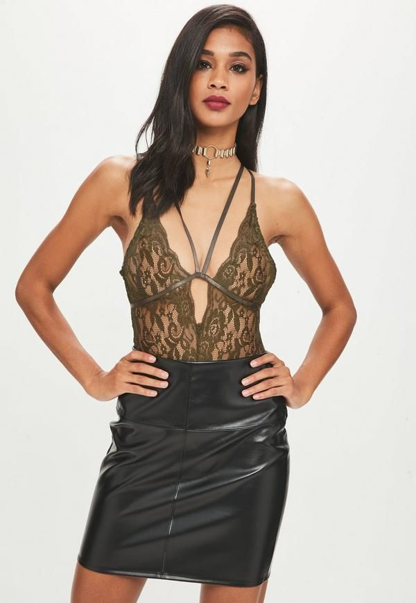 0beeb053 This lace bodysuit features in a khaki hue with a harness strap detail  across the deep