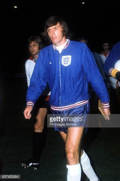 England's Martin Peters walks out before the match