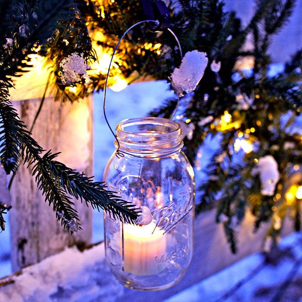 turn classic canning jars into hanging lanterns to light up your outdoor christmas decorating via whitlow bills mcafees