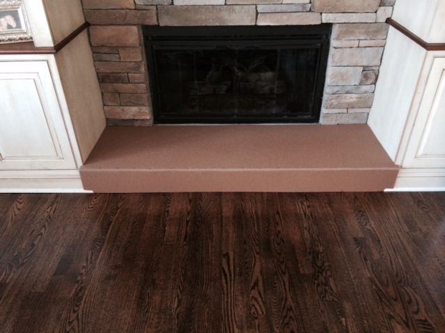 Baby Proof/Child proof your Fireplace with our Fireplace Hearth Guard Pad-a recent after picture of a fireplace with our Hearth Guard providing the needed protection for your child