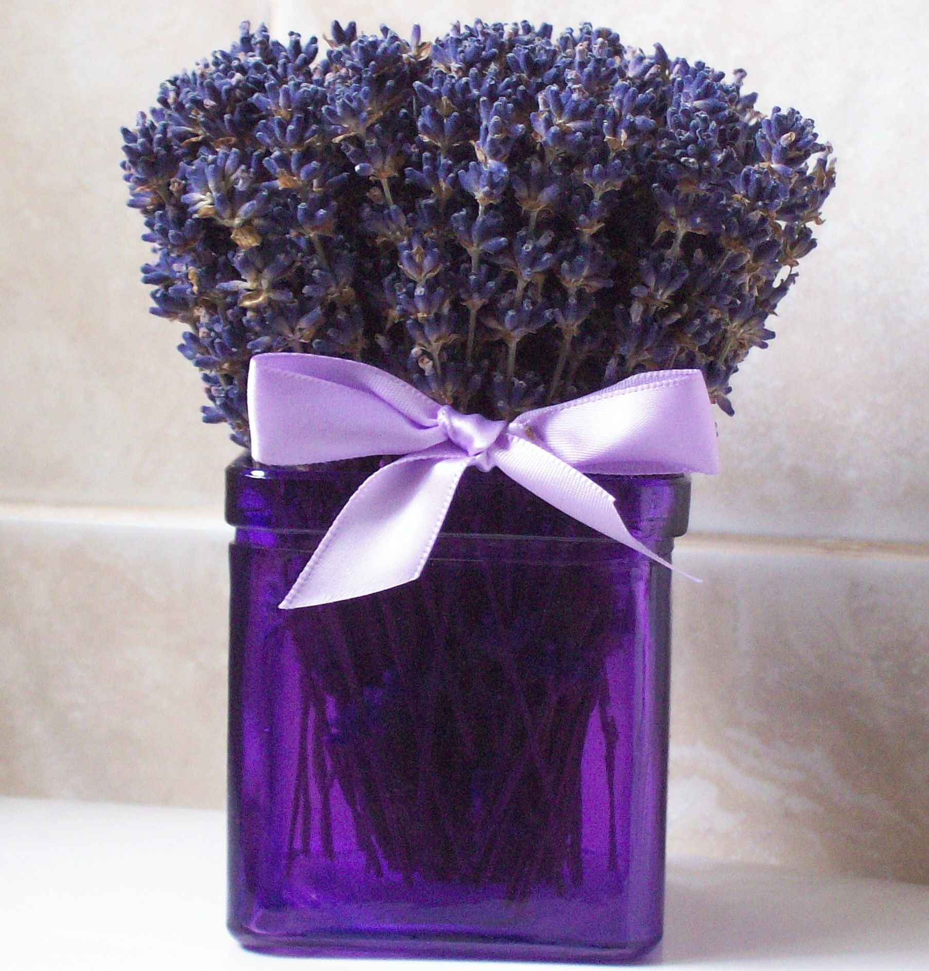Enjoy the soothing scent of dried   lavender with this pretty Mini Lavender   Arrangement.