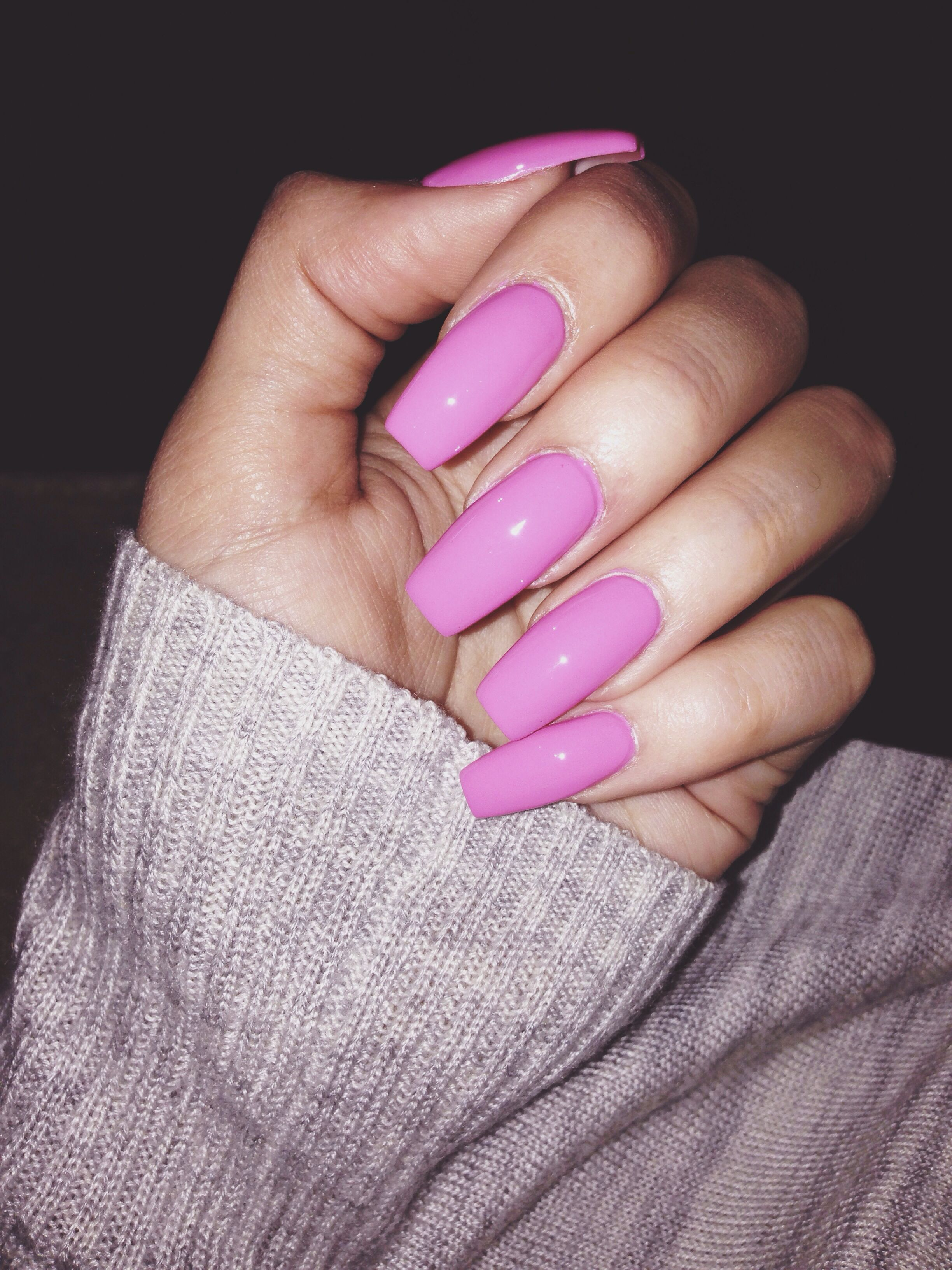 Nail Shape Trends: Long Pink Coffin Shaped Nails.