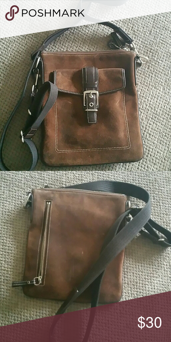 Coach suede crossbody Brown suede crossbody bag with zip closure. Outside has front pocket with magnetic closure and back zip closure Coach Bags Crossbody Bags