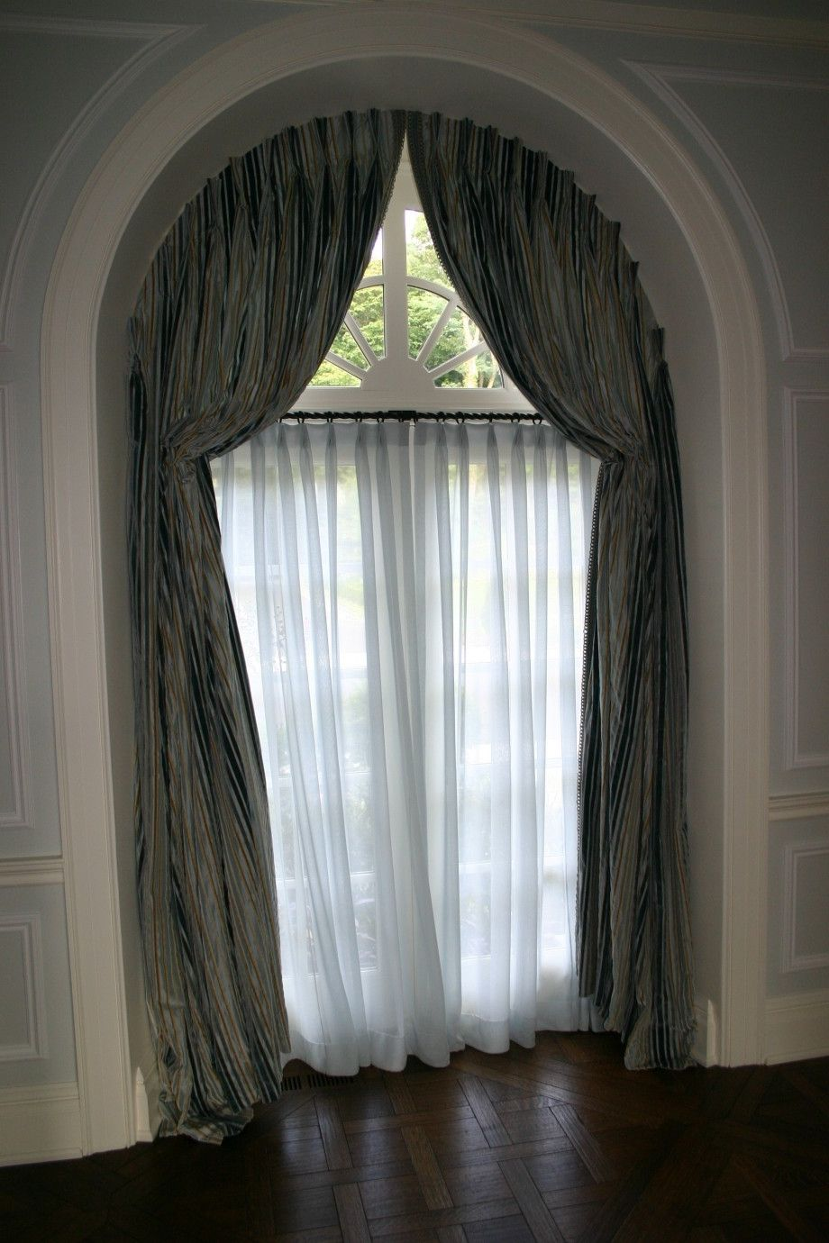 Arched window treatments home decoration ideas half circle for Arch window decoration