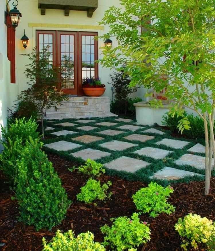 günstige gartengestaltung - steinplatten und ziergras, Gartengerate ideen