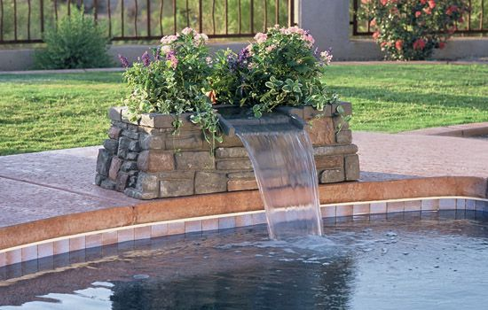 Scupper waterfall into pool the scupper polimer waterfall from interfab is easy to put for Swimming pool fountains waterfalls