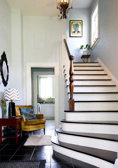 We love the minty-blue wall color in this timeless entryway.
