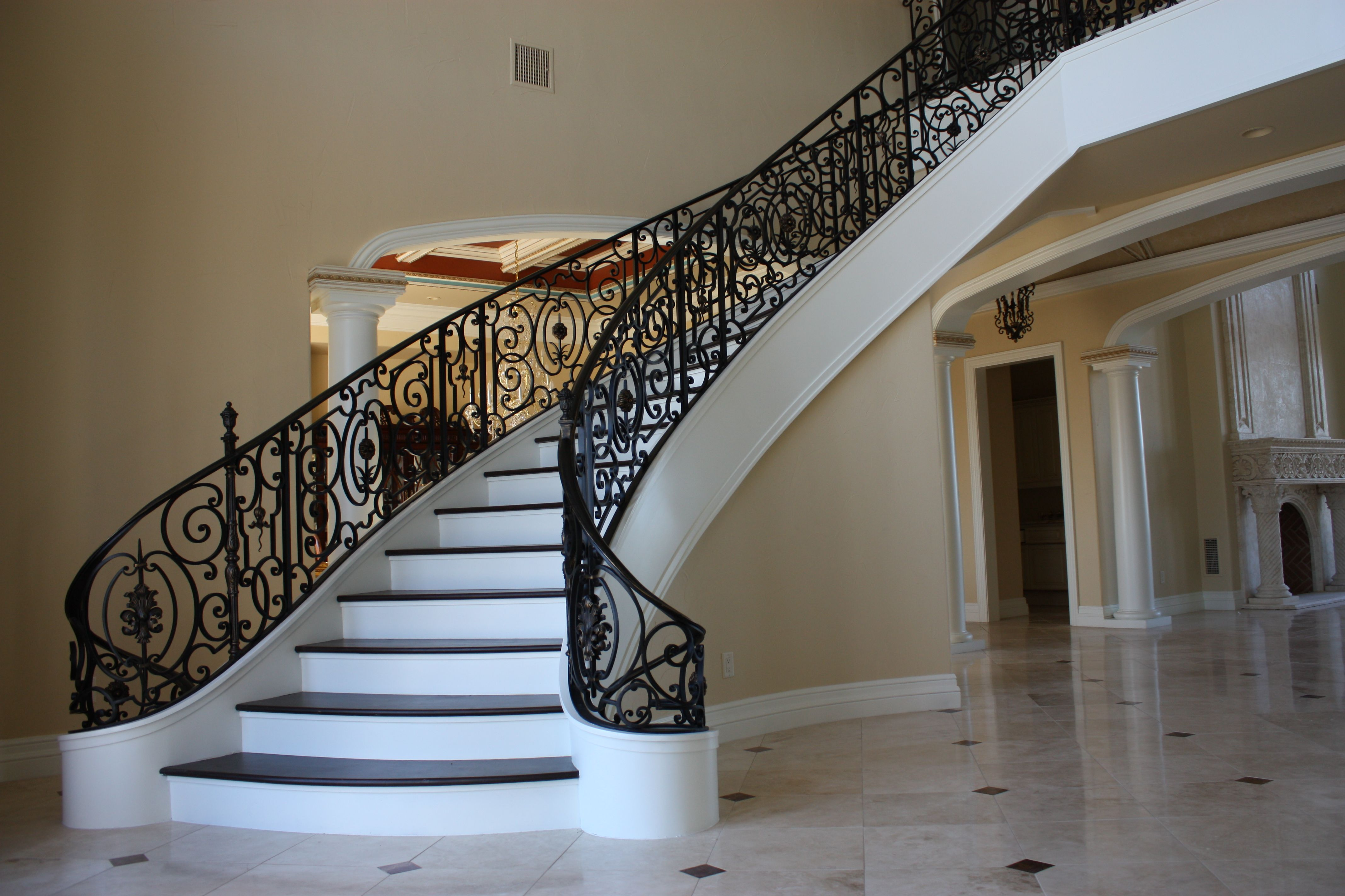 Wrought iron railing inside house - Beautiful Floating Curved Staircase With Iron Railing