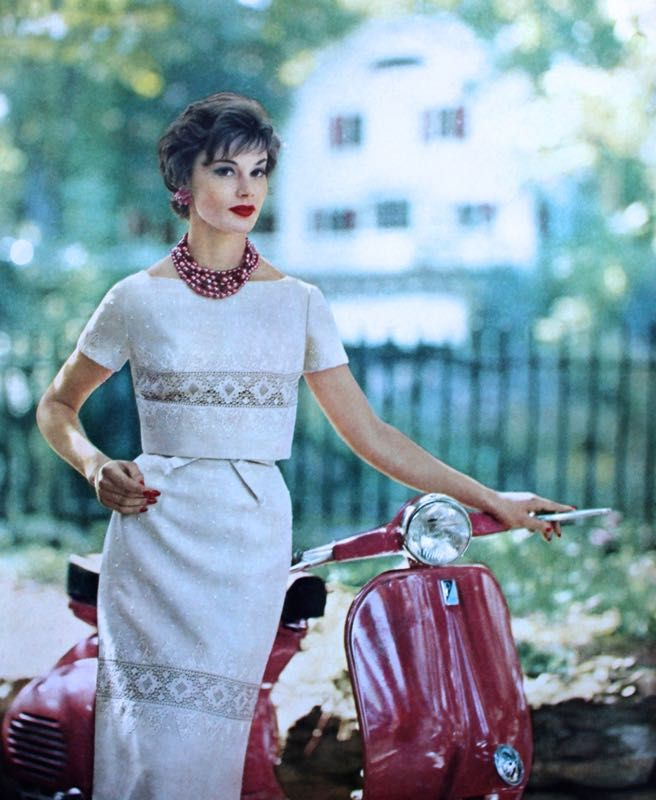 Embroidered dress and bolero by Carlye in Moygashel linen, jewelry Marvella, Vogue US December 1958