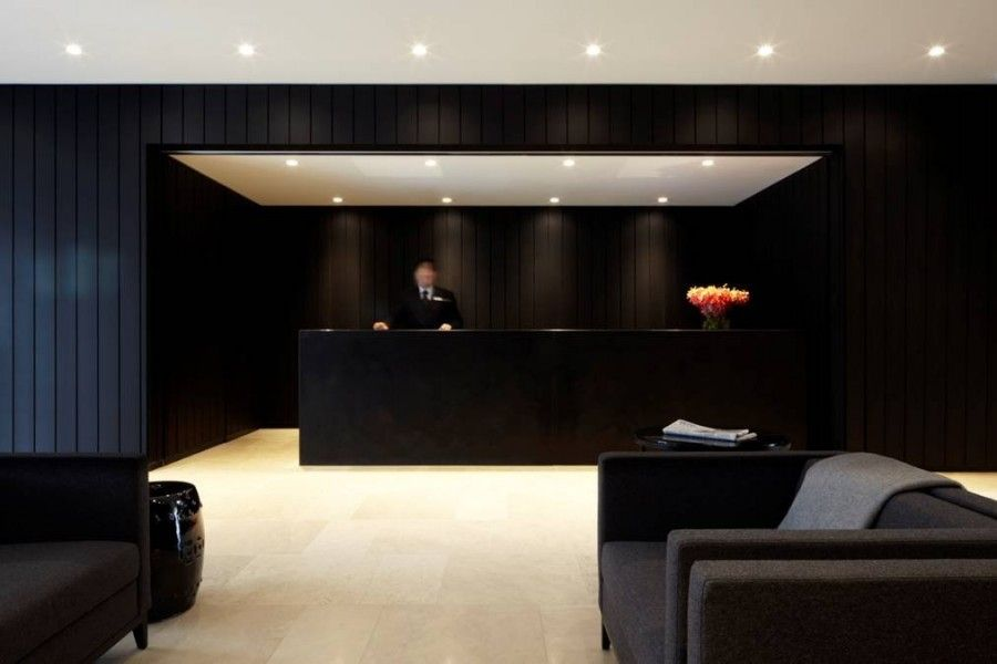 Modern Hotel Lobby Interior Design with Black Furniture and Wall ...