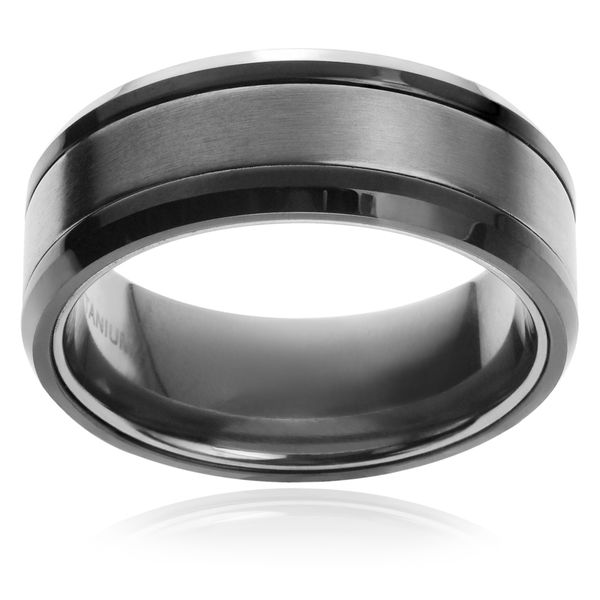 This striking ring from Vance Co. is made from premium titanium and features grooved center to complete this great look. Material: Titanium Band dimensions: 8 mm wide x 2.7 mm thick Styling: Grooved C