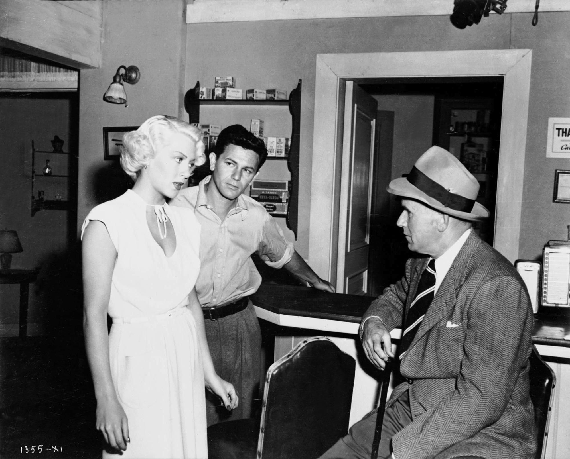 Lana Turner, John Garfield and director Tay Garnett on the set of The Postman Always Rings Twice, 1946.