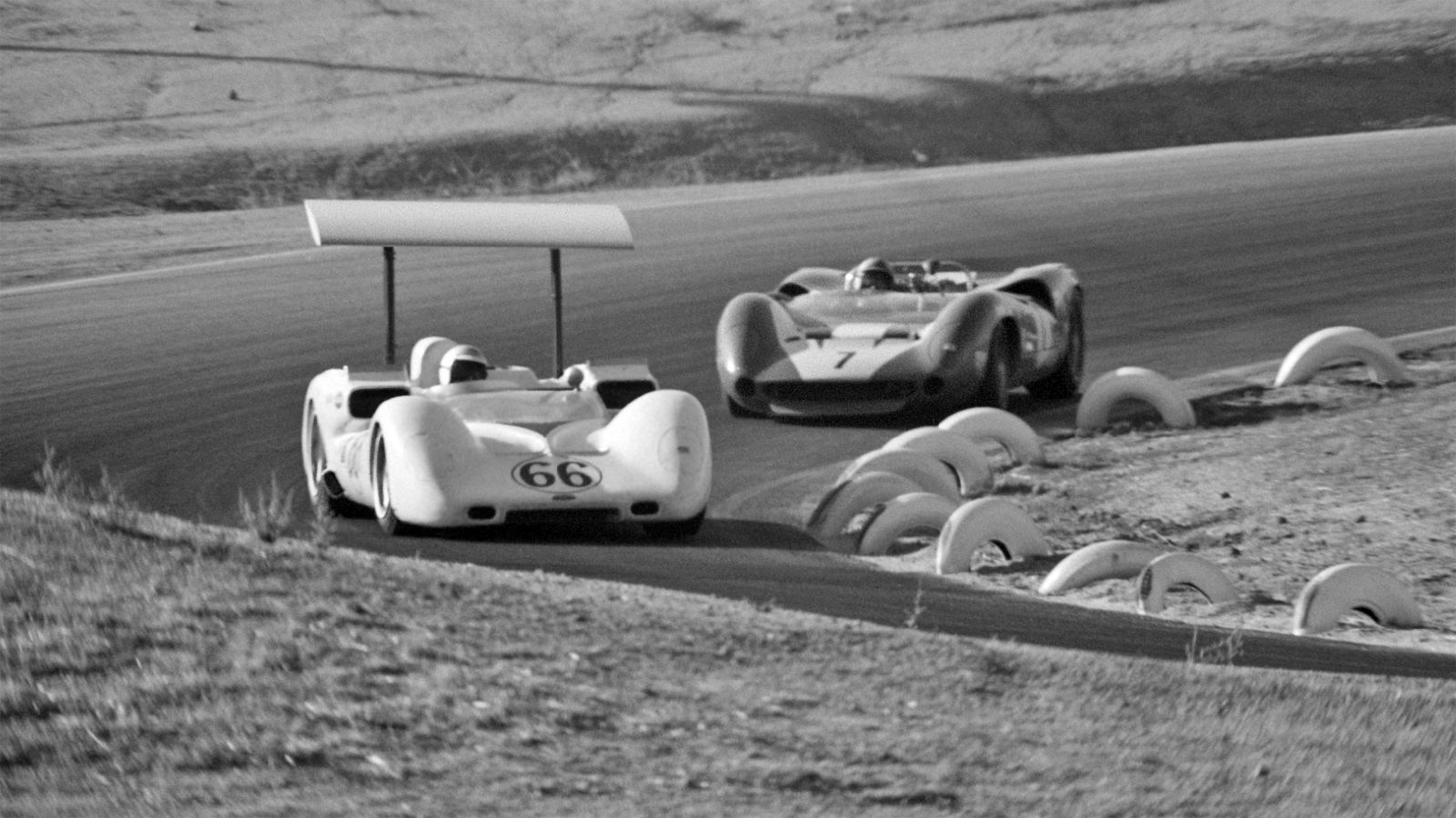 John Surtees Chaparral Jim Hall leads John Surtees at Riverside, 1966. Hall would suffer temporary  fuel starvation