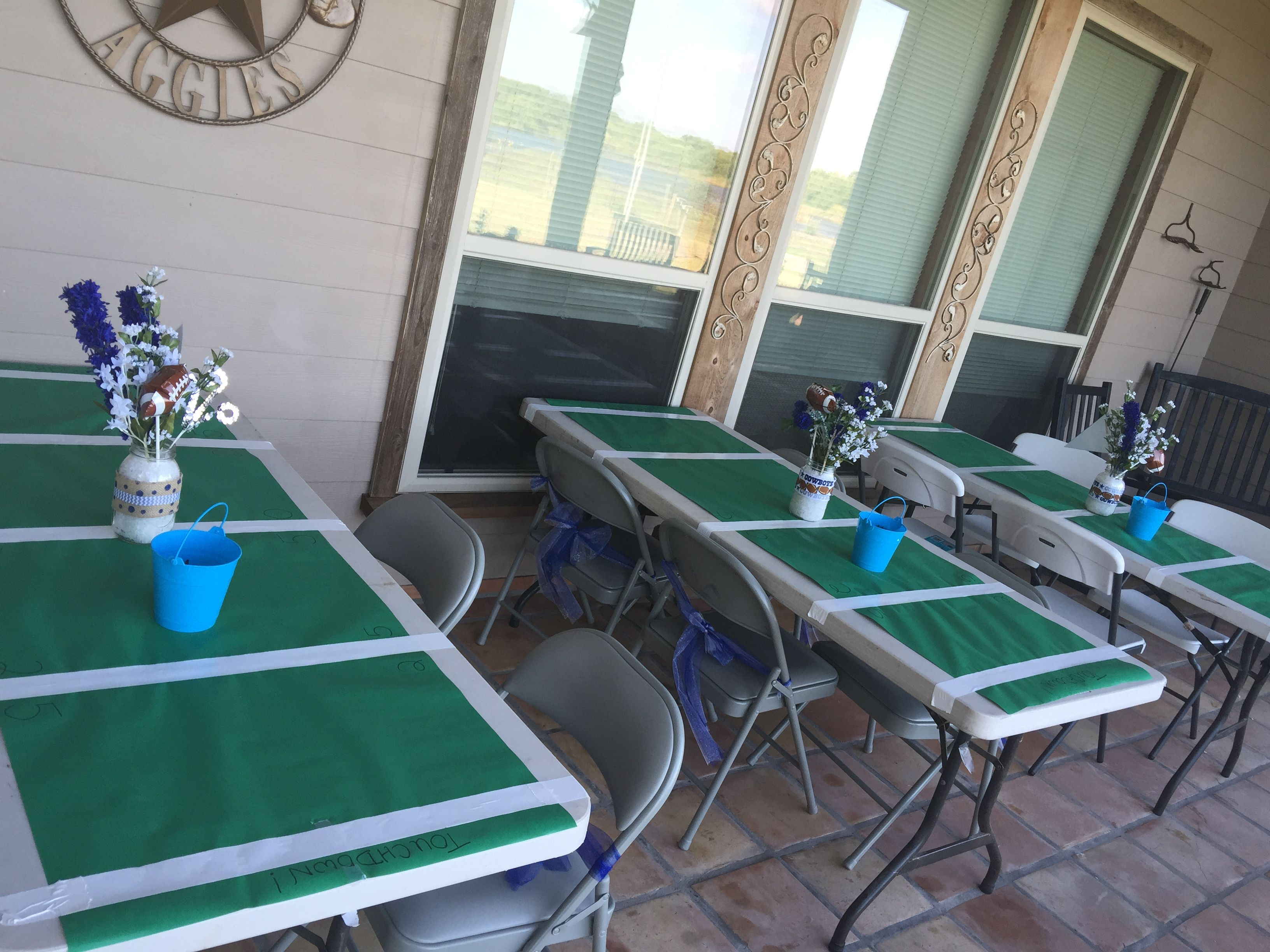Football Tables For Dallas Cowboys Baby Shower With Buckets Of Crayons For The Kids Dallas Cowboys Baby Shower Dallas Cowboys Birthday Party Cowboy Baby Shower