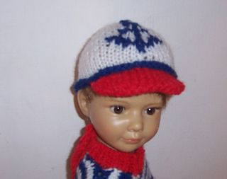 This design is for the slimmer 18 inch dolls. It comprises of a sweater with a 3 button fastening at the back. An anchor motif design round the bottom of the sweater gives it a nautical theme. The baseball style cap has an anchor motif decorating the front This pattern is my own design