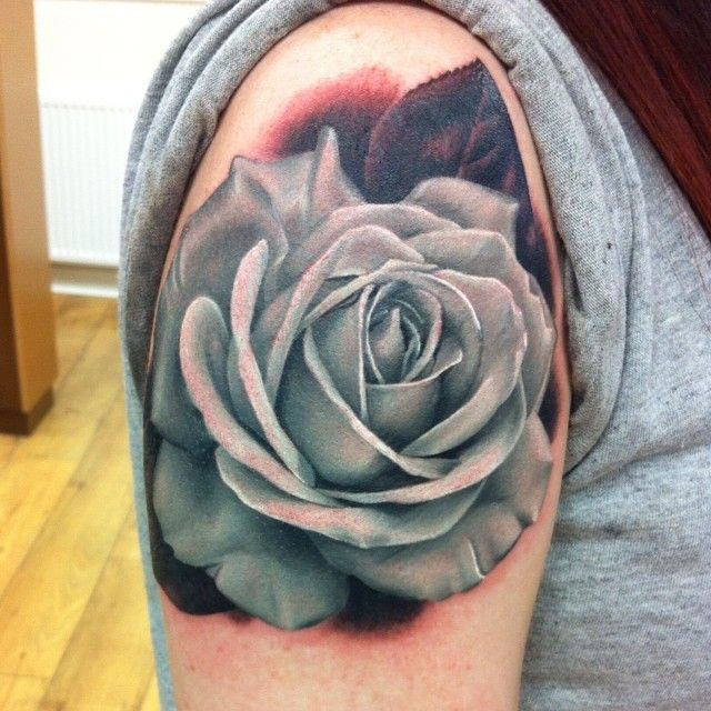 Stunningly beautiful realistic white rose upper arm tattoo by the always amazing Michelle Maddison. So incredibly well done