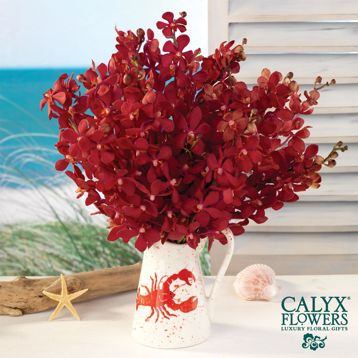 Amazing red mokara orchid, just swap the lobster pitcher for a clear square vase.