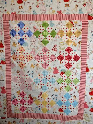 Nanette's darling nine patch baby quilt!