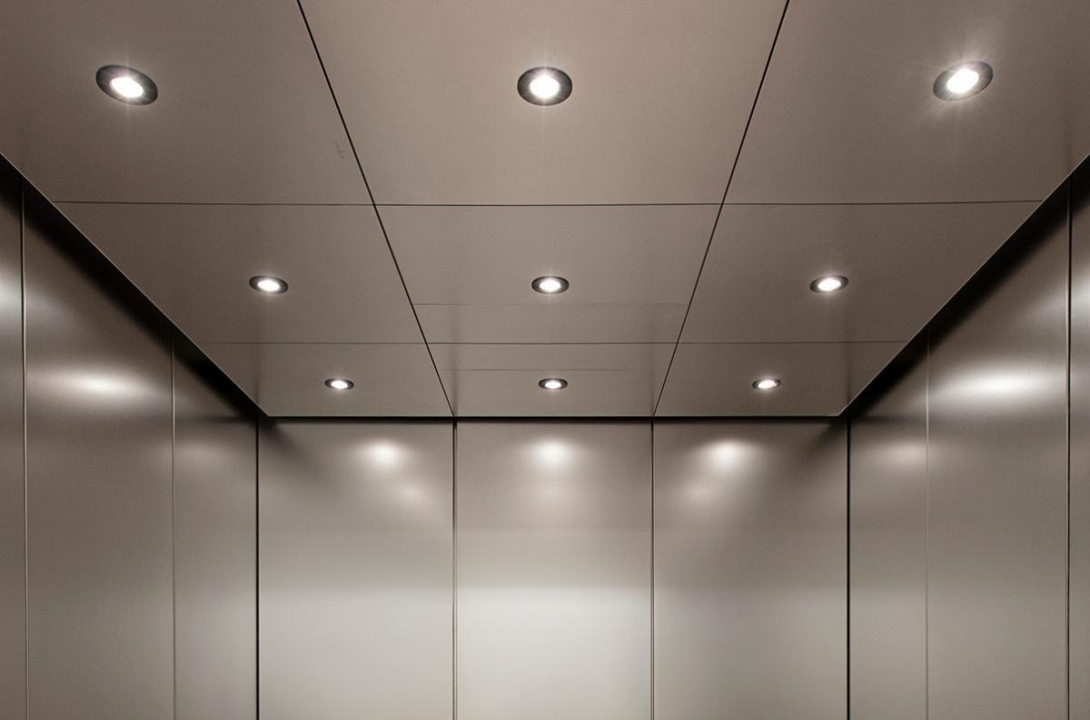 Ark Wood Elevator elevator ceiling in stainless steel with seastone pattern