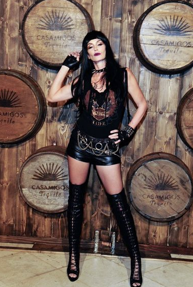 Cindy Crawford dressed as a Hell's Angel biker chick for Halloween.  Get Halloween inspiration by seeing what costumes the A-listers have worn: http://lifestyle.one/grazia/celebrity/style/celebrity-halloween-costumes/