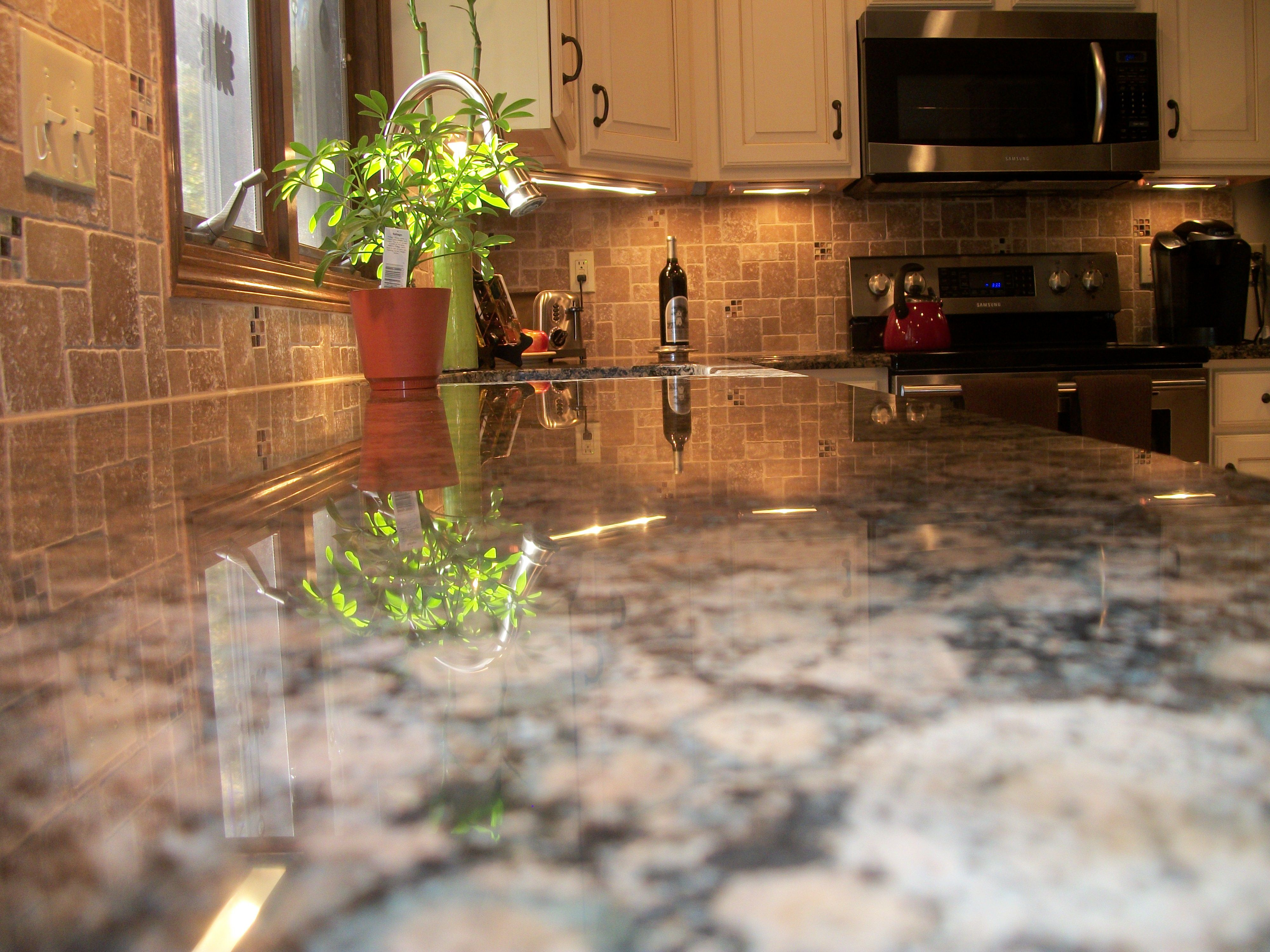 20 best backsplashes images on pinterest backsplash kitchen we installed baltic brown granite countertops and roman stone pattern backsplash with glass accents to beautify