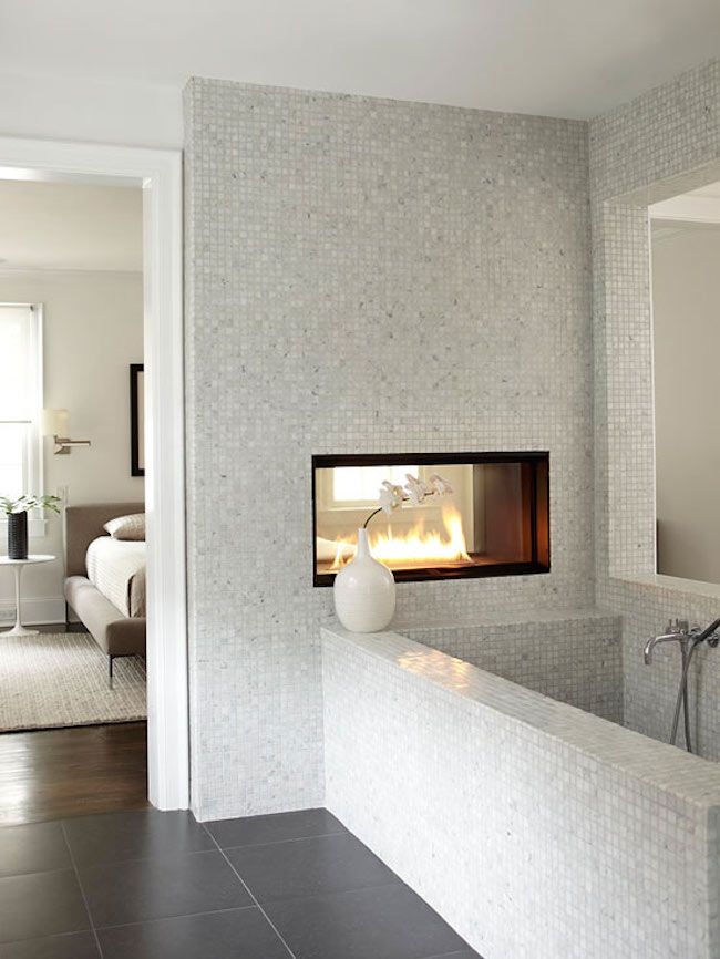 Dual Fireplace In A Marble Tiled Bathroom   Decoist Part 35
